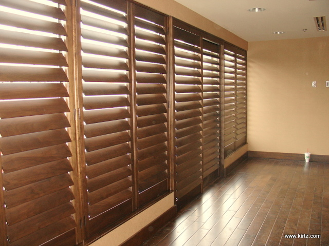 Walnut Planation Shutters, Sliding custom shutters run to the floor