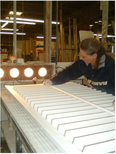 shutters are inspected for flaws under high intensity lights