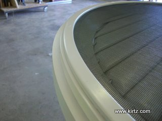 Trim covers insect screen in this custom shutter