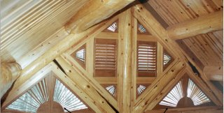 This Log Home Used Plantation Shutters For Their Shaped Windows