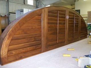 Notice the elliptical curvature of this custom walnut shutter.