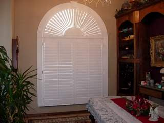 arch 1/2 circle window with plantation shutters and sunburst top