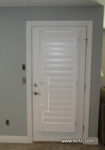shutters on a french door with lever handle, square cut out.